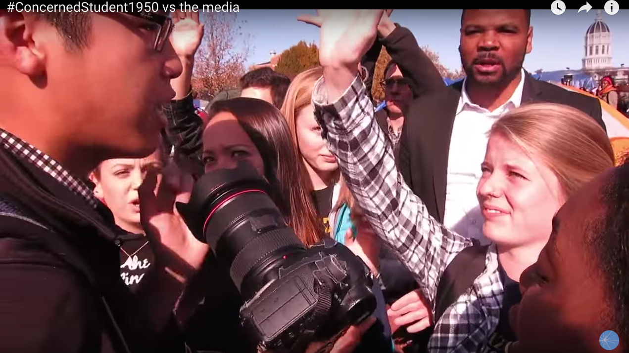 Protesters challenge a member of the media at the University of Missouri. Courtesy of Youtube.