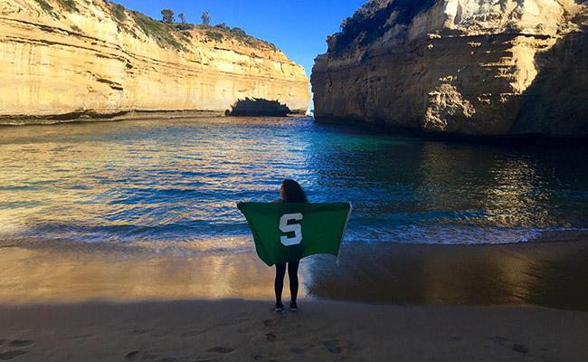 Maddie Ebbing waves a Spartan flag.