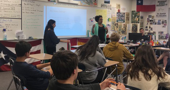 Taylor Hall teaches an Intercultural Dialogues lesson in a high school classroom.