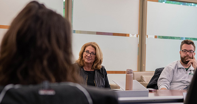 Donna Rich Kaplowitz works with students during an MSU Dialogues session.