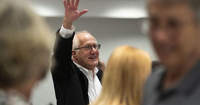 Dick Prawat waiving at his retirement celebration.