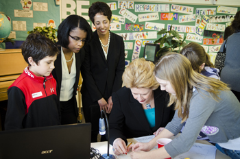 Associate professor Michelle Williams (left) and Angela DeBarger watch as U.S. Sen. Debbie Stabenow learns about the STEMGenetics curriculum. Photo by Jeff Seguin.