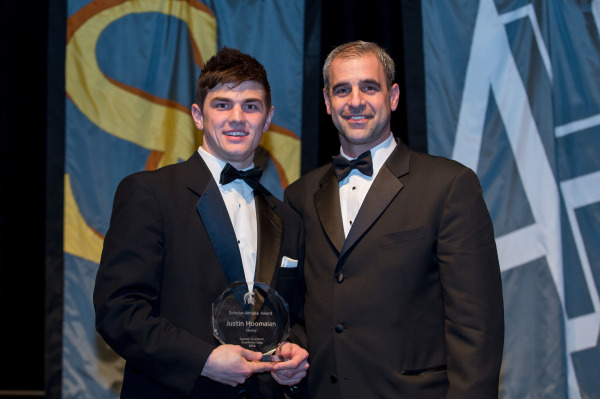 Scholar-Athlete Award winner Justin Hoomaian with Tom Anastos (right), men's hockey head coach.