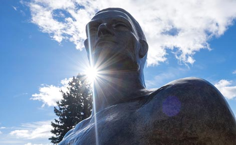 Sparty statue is shown with sunlight behind.