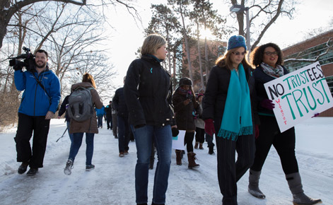 Individuals march from Erickson Hall to the Hannah Administration Building.