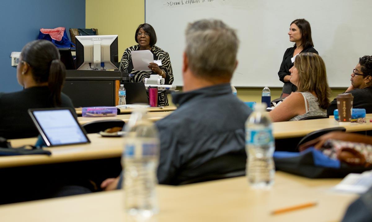 MSU faculty members addressing Flint teachers